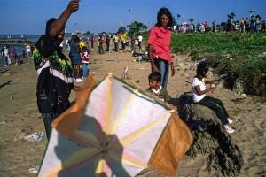 Easter kite flying along the seawall. Georgetown, Guyana